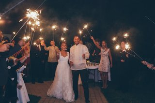 bride-and-groom-hold-sparklers-at-wedding-reception