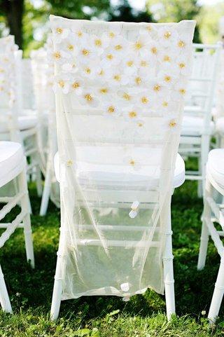 white-chiavari-chairs-with-sheer-daisy-covers