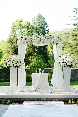 all-white-wedding-ceremony-arch-and-flowers