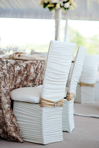 white-chairs-with-ruched-cover-and-rhinestone-buckle