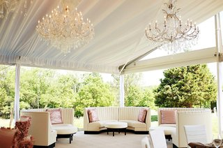 ivory-booths-in-lounge-area-at-tent-wedding