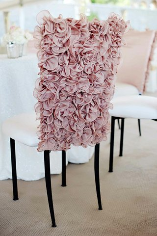 pink-wedding-chair-cover-with-ruffled-fabric