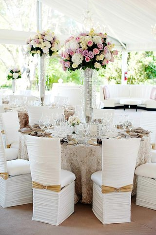 tent-wedding-table-arrangement-with-textured-linens