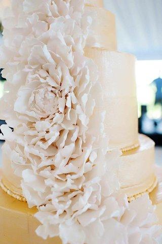 white-peony-flowers-cascading-down-wedding-cake