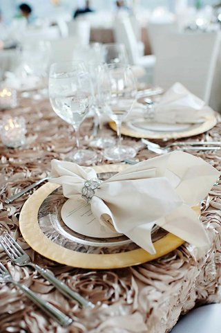 textured-taupe-linens-with-gold-charger-and-linen-napkin
