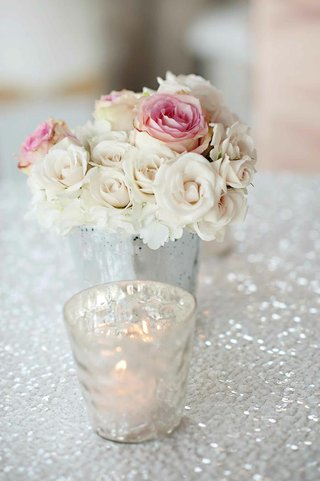 small-centerpiece-of-roses-on-white-sequin-tablecloth