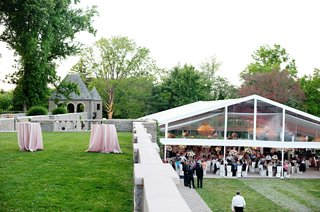 white-tent-with-clear-sides-on-lawn-at-beautiful-venue
