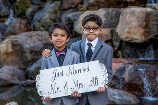 young-indian-boys-holding-handpainted-sign