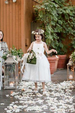 flower-girl-in-tea-length-white-dress-and-moss-basket