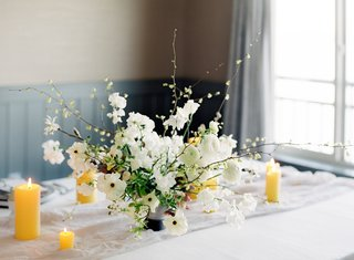 small-flower-arrangement-with-white-japaense-ranunculuses-and-corylopsis-extending