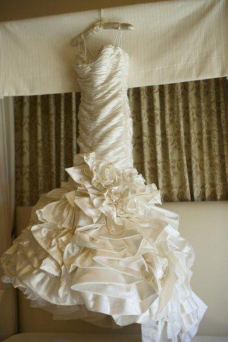 white-wedding-dress-on-hanger-in-hotel-room