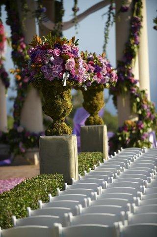 outdoor-wedding-ceremony-moss-covered-flower-arrangement