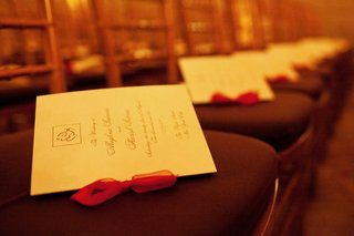 north-indian-hindu-wedding-booklets-on-chairs