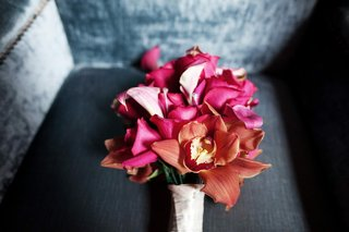fuchsia-calla-lily-and-orchid-flowers-on-couch