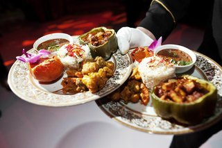 gold-rimmed-plates-with-traditional-food-from-india