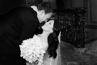 black-and-white-photo-of-groom-dipping-bride-on-dance-floor