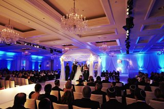 indoor-jewish-wedding-ceremony-with-blue-lighting