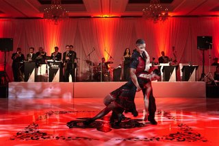 red-wedding-reception-lighting-with-professional-dance-entertainment
