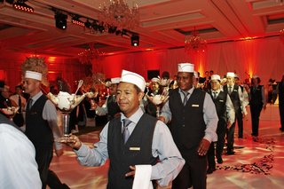 waiters-in-paper-hats-delivering-martini-glass-desserts