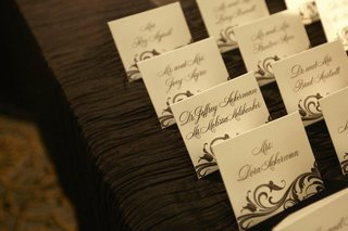 black-and-white-escort-cards-with-scroll-pattern