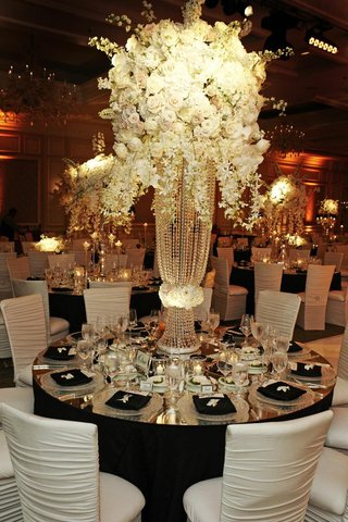 white-flowers-on-top-of-crystal-strand-riser-wedding-centerpiece