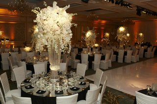 white-roses-and-flowers-on-large-crystal-strand-stand