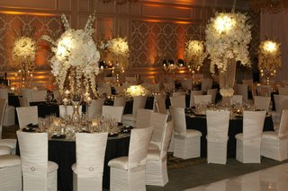 chameleon-chairs-around-black-wedding-tables
