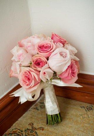 pink-and-blush-roses-wrapped-in-satin-ribbon