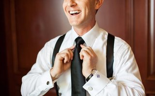 groom-getting-ready-and-tying-black-tie