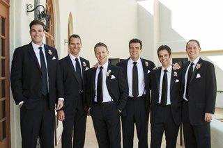 groom-and-groomsman-black-suit-attire