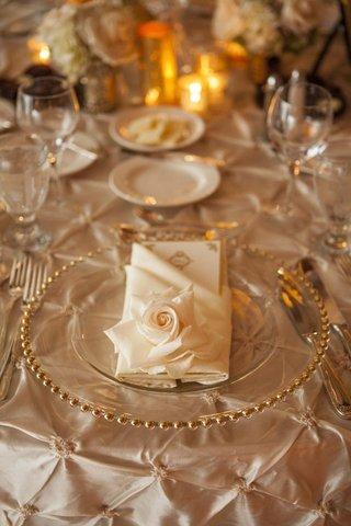gold-rimmed-charger-plate-and-rose