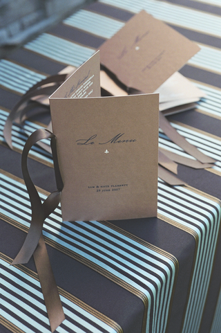 tan-booklets-tied-with-brown-ribbon