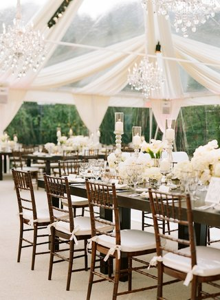 wood-reception-tables-with-white-flower-centerpieces