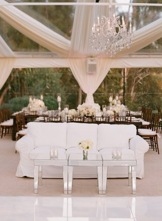 white-slipcover-couch-next-to-dance-floor-at-reception