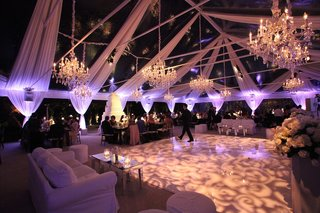 patterned-dance-floor-with-white-drapery-and-chandeliers