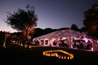 candle-heart-outside-wedding-reception-tent