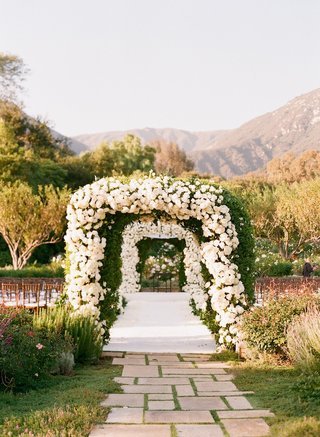 white-rose-and-greenery-arches-at-ceremony-aisle-entrance