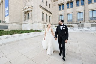 bride-in-v-neck-wedding-dress-tulle-overskirt-groom-in-tuxedo-portraits-at-chicago-field-museum