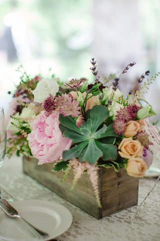 rustic-centerpiece-with-pink-peonies-succulents-peach-roses-in-wooden-planter