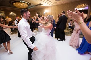 bride-in-reem-acra-ball-gown-dances-with-husband-and-guests-at-wedding-reception