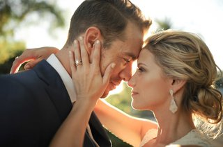 tim-lopez-and-jenna-reeves-wedding-couple-portrait-sunlight-teardrop-engagement-ring-earrings