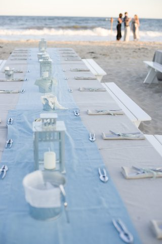 long-picnic-table-on-beach-sand