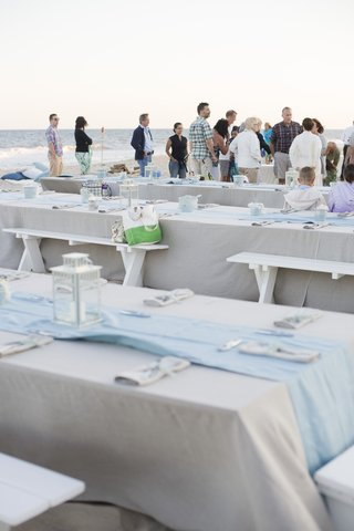 picnic-tables-and-guests-on-sand