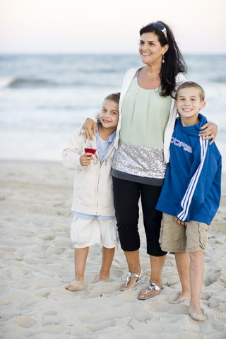 children-and-mother-on-sand