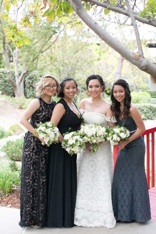 bride-bridesmaids-black-gray-dresses-different-patterns-white-bouquets-outdoor-california-wedding