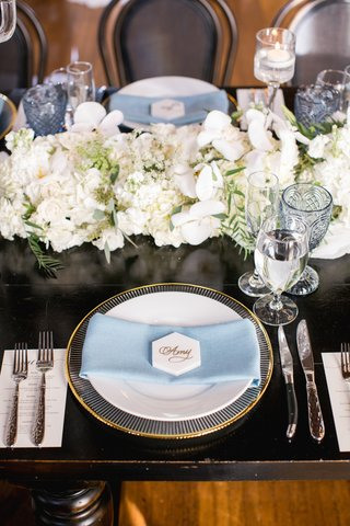 gold-rimmed-charger-pale-blue-napkin-hexagonal-marble-place-card