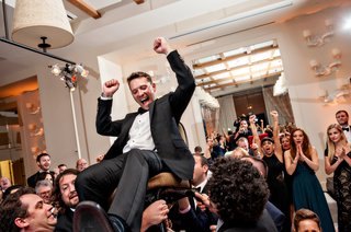 traditional-jewish-hora-chair-dance-at-indoor-wedding-reception
