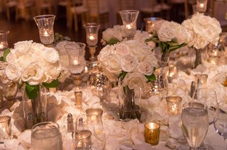 classic-wedding-with-white-roses-and-crystal-candle-holders-gold-votives
