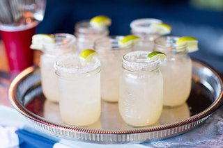 margaritas-in-mason-jars-rimmed-with-salt-and-garnished-with-limes