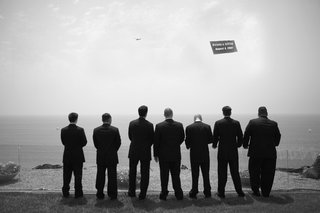 black-and-white-photo-of-groomsmen-and-ocean